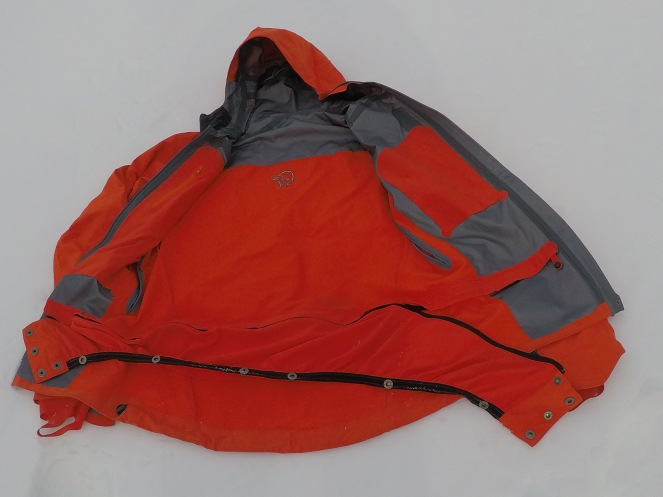 Snowskirt being partially unzipped from the right