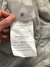 Attached to the base of the sleeping bag, detailing the sleeping bag unique number and grooving it adheres to the qualities it advertises
